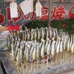 Fish on a stick - Murayama Park, Kyoto. Taken during Hanami season, many small vendors prepare food for those sitting under the trees - in this case, grilled fish eaten whole